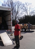 Volunteers loading donations